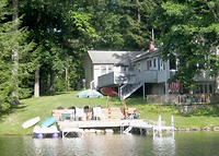 Wooded lakefront home: swim, fish, boat, hike, discover nature.