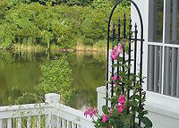 Relaxing sunset views of Pond. Wide sandy Beach, Pools, Biking, Golf.