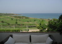 Front line 3 bed townhouse overlooking golf, beach & Mediterranean.