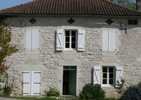 Pretty stone house in a village in South West France with heated pool.