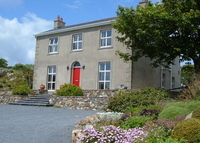Tramore, Co Waterford. Restored farmhouse with large garden.