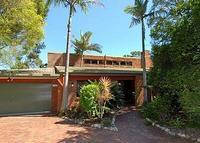 Sub tropical tri level home in quiet upmarket residential area.