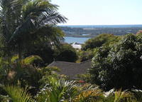 Lovely two storey open plan home, with views to the ocean and green rolling hills in a sub tropical setting.