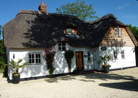 Riverside Thatched Cottage + a Converted Old Forge!