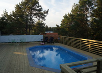 Villa (with pool) in Sthlm & an old log house in northern Sweden