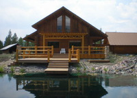 Log Home in the Swan Valley with private swimming pond