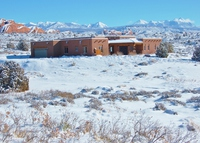 New (2008) southwest-style house facing high cliffs and La Sal Mtns.