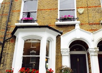 Family house in leafy Islington, near shops, pubs, tube, park, farm.