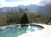 Enjoy poolside Catalina Mtn views in upscale home on acreage
